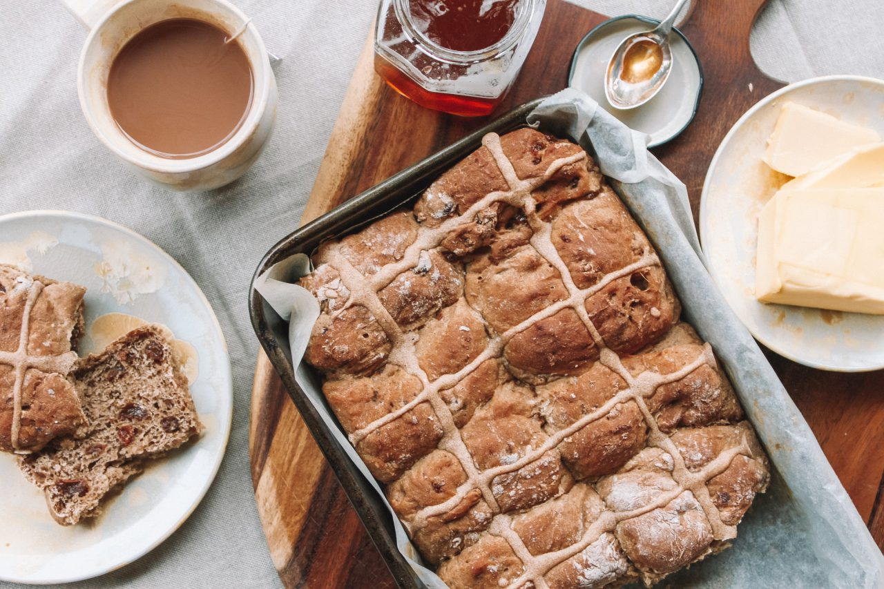 A table of Easter Hot Cross Buns